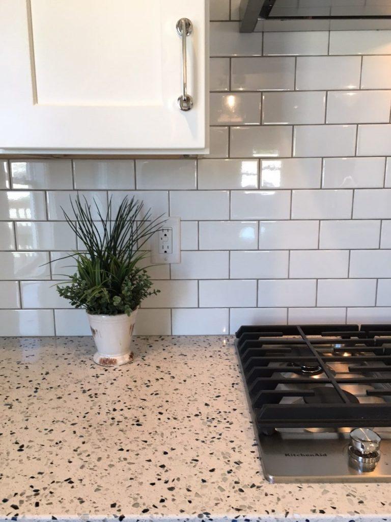 Simple tile meets extravagant top | Degraaf Interiors